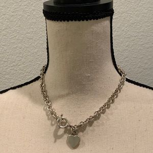 Sterling silver link necklace with heart charm.